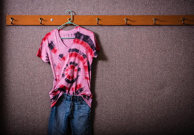 Jeans and an oversized tie dye shirt.